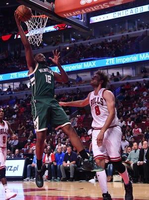 Bucks forward Jabari Parker (12) shoots the ball against Chicago Bulls center Robin Lopez (8) during the second half at the United Center.