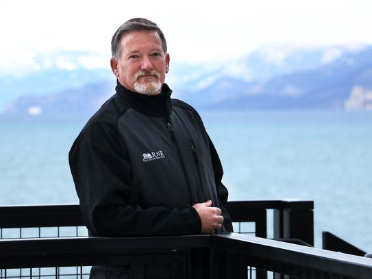 Stu Roberson of RnR Vacation Rentals stands in the