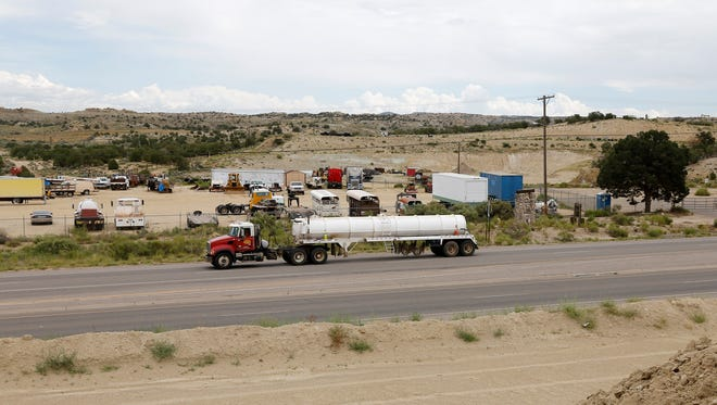A commercial truck on July 14 drives south on U.S. Highway 550 south of Aztec.