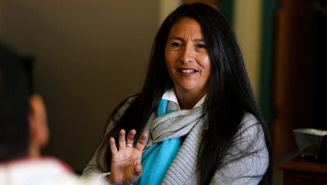 Center for Working Families Director Ceceilia Tso talks about her program Tuesday at San Juan College in Farmington.
