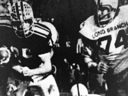 Red Bank running back Bob Tomaino picks up yardage against Long Branch in 1974.