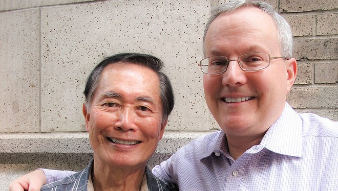 "Actor George Takei, left, and longtime partner, manager and now husband, Brad (Altman) Takei in a scene from the documentary motion picture ""To Be Takei."""