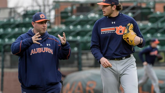 Auburn head coach Butch Thompson talking to pitcher Gabe Klobosits during baseball practice on Friday, Jan. 27, 2017 in Auburn, Ala.