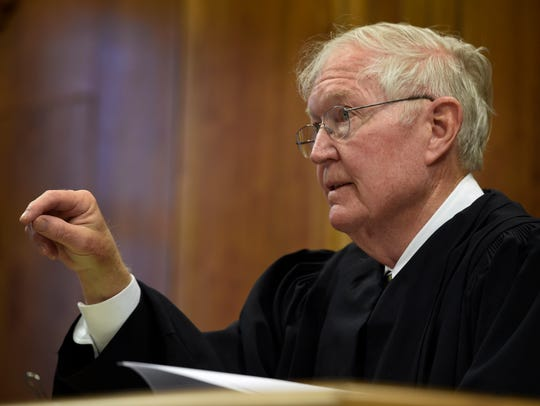 Judge William Acree asks questions of attorneys during
