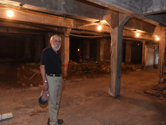 Roy Budnik, a geologist and owner of 489 Main Street in the City of Poughkeepsie, pictured in the lower level of the property.