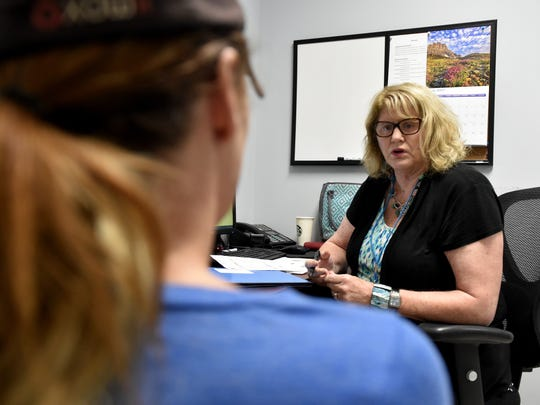 Beth Meyer-Frank, a nurse practitioner at Aegis Treatment Center in SImi Valley, speaks with a woman struggling to beat a heroin addiction. Meyer-Frank recommended increasing the woman's dosage of methadone.