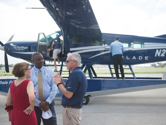 """""""I am excited that has come to St. Lucie County and even more excited about the possibilities because this will show others how welcome they are,"""" said state Rep. Larry Lee (center), with state Rep. Gayle Harrell (left) and Fly the Whale Director of Operations Kurt Holden, on Friday, October 20, 2017, about the new Fly the Whale flights being offered out of the Causeway Cove Marine and Treasure Coast International Airport north of Fort Pierce. Lee said he is optimistic that new business can be successful in St. Lucie County. """"We want to see them coming and growing with us."""""""
