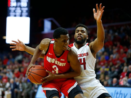 Rutgers Scarlet Knights guard Souf Mensah (44) defends
