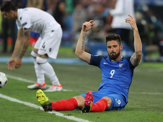 France's Olivier Giroud, right, gestures as Albania's Elseid Hysaj  reaches for the ball during the Euro 2016 Group A soccer match between France and Albania at the Velodrome stadium in Marseille, France, Wednesday, June 15, 2016. (AP Photo/Thanassis Stavrakis)