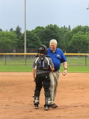 FILE - Manitowoc Youth Baseball Association President Randy Heinzen shakes hands with a player following his ceremonial first pitch at the new Manitowoc Youth Sports Complex in 2017.