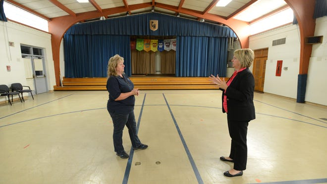 Anna Tobin, right, executive director of Meals on Wheels of Fairfield County, and Cindy Wells, director of operations for the agency, stand in the gymnasium of Cedar Heights Elementary School Friday, June 30, 2017, in Lancaster. Meals on Wheels plans to renovate Cedar Heights to become the group's new base of operations. The gymnasium and stage will be split between the dinning room and new kitchen.