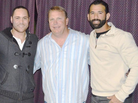 Chipola College baseball coach Jeff Johnson (center) with former players Russell Martin (left, Toronto Blue Jays) and Jose Bautista (Blue Jays).