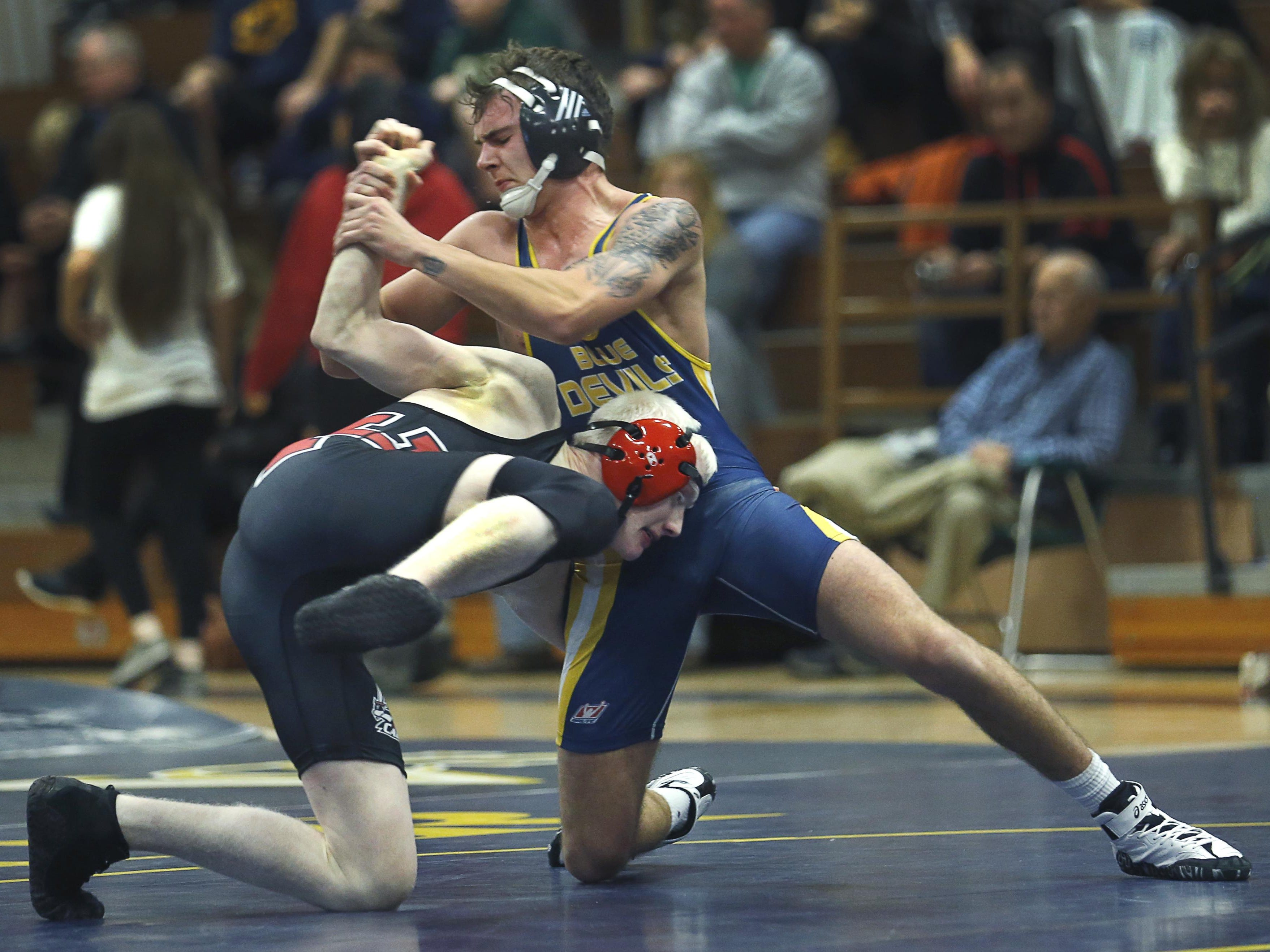 Victor's Nate Fedick defeated Hilton's Tom Foos in the 145-pound weight class at Victor High School.