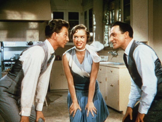 "Donald O'Connor as Cosmo Brown, Debbie Reynolds as Kathy Selden, and Gene Kelly as Don Lockwood during the musical number ""Good Morning,"" in a scene from the motion picture ""Singin' In the Rain."""