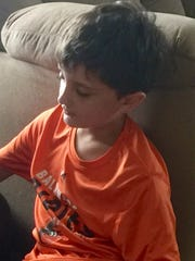 Trevor Lilley, 10, loves on his nana's dog, Hershey,