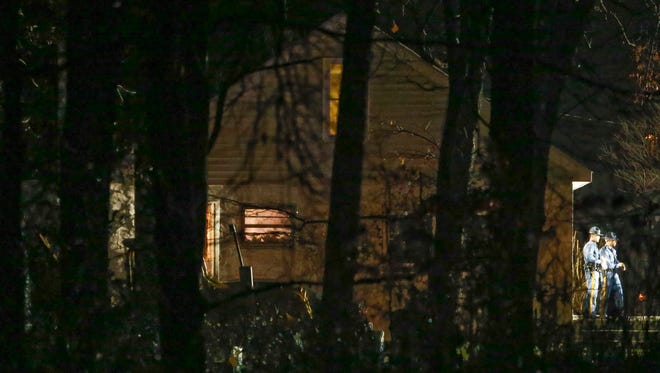 State police officers work at the scene of an apparent shooting at a house on Salem Church Road, reported about 10:45 p.m. Thursday.