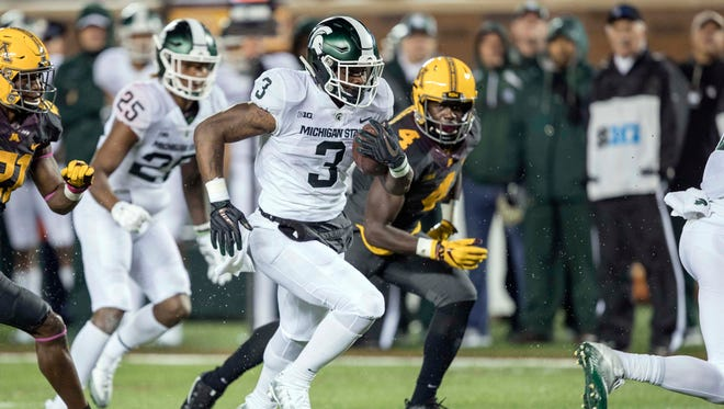 Michigan State Spartans running back LJ Scott (3) rushes with the ball for a touchdown in the first half against the Minnesota Golden Gophers at TCF Bank Stadium.