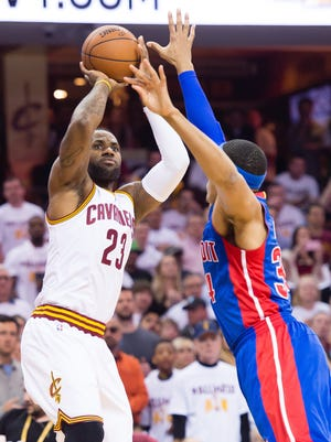 Cavaliers star LeBron James shoots over Tobias Harris during the first half.