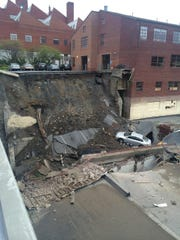 A view of the collapse of a parking area in Harrisburg