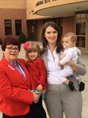 """Claire Parsons, center, with her daughters and mother Gayle Hoffman, left, after voting in Union, Ky. on Election Day. Parsons tweeted """"Voting for my girls, with my girls"""" on Election day."""