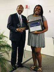 Monet Moore accepted the Neighbor of the Year award on behalf of Leslie Harris from the Providence Neighborhood.