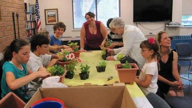 Dutchess Garden Study Club held its summer meeting working with grandchildren of members making July 4th floral arrangements.