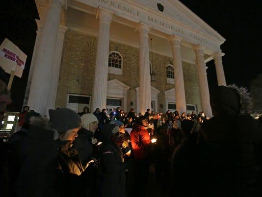 636213969376895988-012917-APC-Candlelight-vigil-rbp-118.jpg