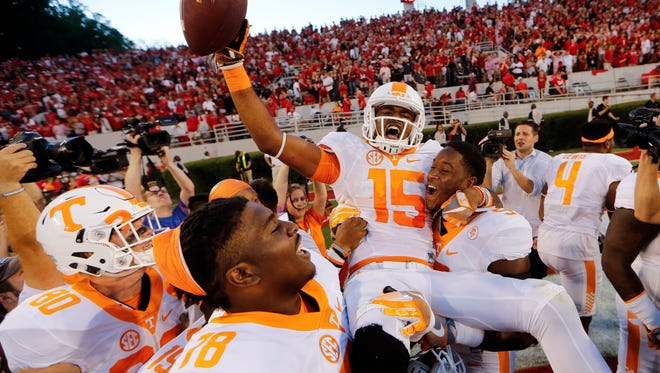 Tennessee wide receiver Jauan Jennings (15) is carried by teammates Kyle Phillips (5) and Charles Mosley (78) after making a last-second touchdown catch to defeat Georgia 34-31 on  Oct. 1, 2016.