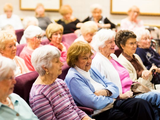 "Audience members listen to author Dorothy Jane Mills, a resident of The Carlisle Naples, as she discusses her latest three-volume mystery series, ""Don't Admit You're In Assisted Living,"" on Monday at the retirement community."