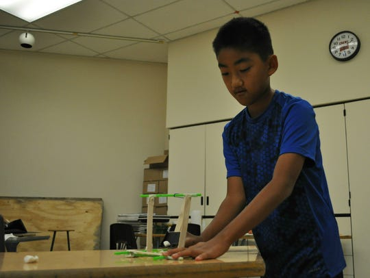 10-year-old Matthew Schmidt practices with his catapult