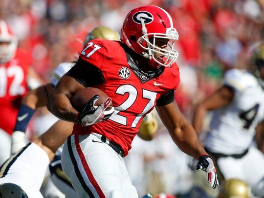 Georgia running back Nick Chubb (27) runs the ball