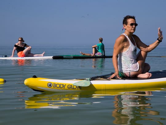 Jodi Ziajka, right, a yoga instructor with the Naples