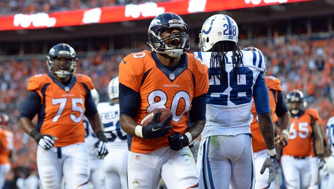 Broncos tight end Julius Thomas (80) reacts to his touchdown in the second quarter against the Colts at Sports Authority Field, Sept. 7, 2014.