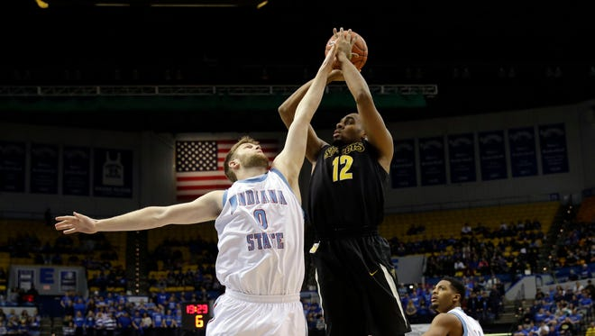 Darius Carter shoots over Indiana State forward Jake Kitchell.