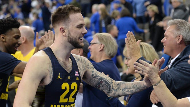 Marquette Golden Eagles guard Katin Reinhardt, right, and guard Jajuan Johnson, left, greets fans after the win against the Creighton Bluejays at CenturyLink Center on Saturday.