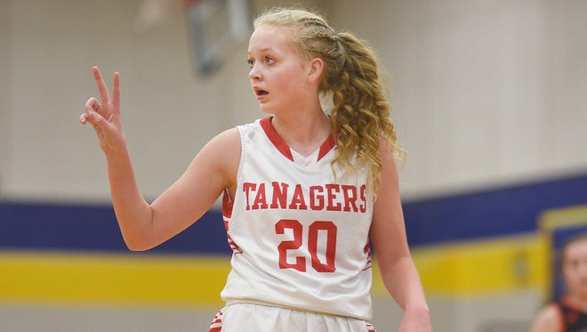 Vermillion's Lexi Plitzuweit communicate with her coach during the game against Dell Rapids Thursday, March 1, at Tea Area High School in Tea.