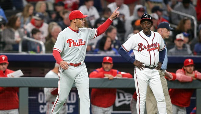 Phillies manager Gabe Kapler makes a pitching change against the Braves in the third inning at SunTrust Park in Atlanta.