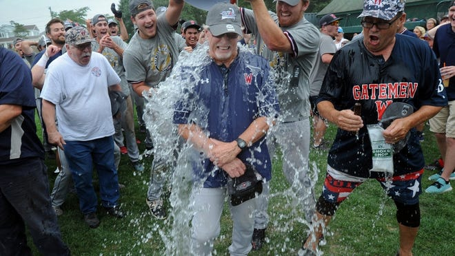 """""""It represents all those players who have played for me. They're the ones who made me have success. To be a part of their club is quite a thrill for a small college coach in Southern California,"""" said manager Don Sneddon, here celebrating the Wareham Gatemen's 2018 Cape League championship, on being inducted into the ABCA Hall of Fame this January."""