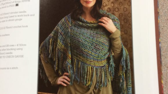 This shawl has a fairly straightforward lace pattern with an eight-row repeat.