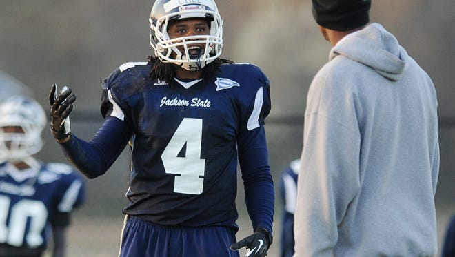 Linebacker Ariane McCree talks to a coach during practice at JSU .