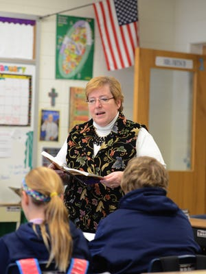 Teacher Gayle Fritsch teaches sixth-grade religion class Wednesday at St. John the Baptist Catholic School in Howard.