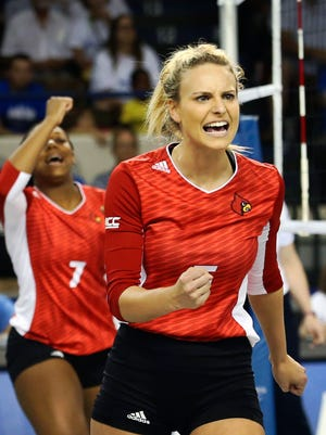 Louisville's Katie George and Erin Fairs (#7) celebrate during a match last month against Kentucky. Sept. 20, 2015