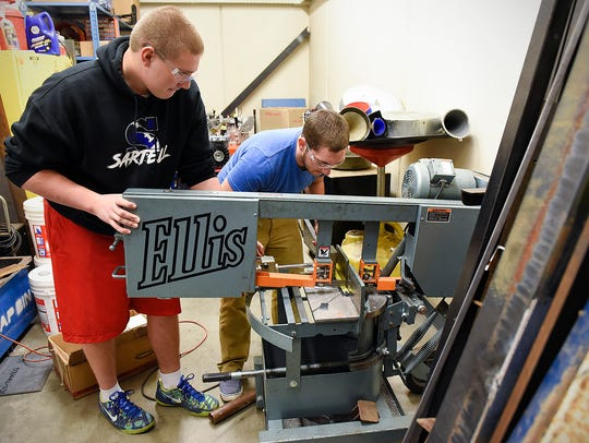 Sartell High School students Trevor Raths, left, and