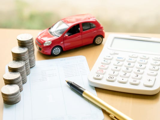 Coins stack in columns on saving book and car
