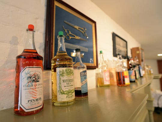 Bottles of lineaments and salves are on display at the Georgian Museum in downtown Lancaster. The display is on loan from the National Barber Museum and Hall of Fame in Canal Winchester.