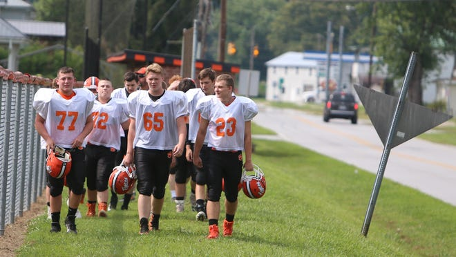 Rosman High's football players make their way to their first practice last year.