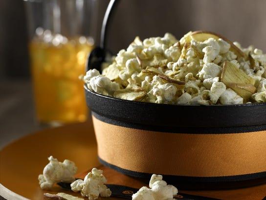 Crispy crunchy apple popcorn features baked apple chips.