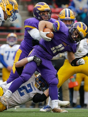 New Berlin Eisenhower running back Jake Belongia is tackled by Rice Lake's Averie Habas (bottom) in the second quarter during the WIAA Division 3 state football championship game.