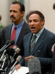 Former Agriculture Secretary Mike Espy, right, with