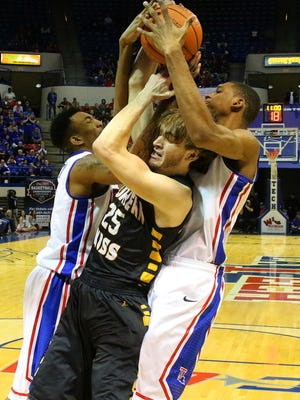 A pair of Bulldogs tie up USM Jamie Chapman in 1st half action Thursday night at the TAC in Ruston.